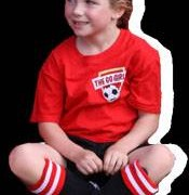 Young girl team member of The Go Girls Social Grade Soccer Team wearing her custom red team t-shirt, embroidered with white and black text and logo on the front.