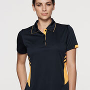 2311 Womens Tasman Polo - Black/Gold on Female Model