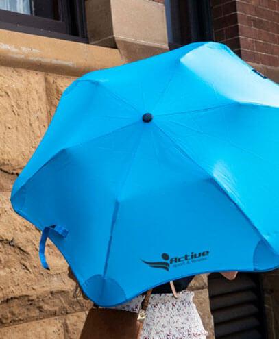 118435 BLUNT Metro Umbrella held by Model, in Light Blue