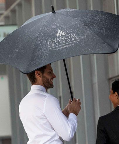 118438 BLUNT Exec Umbrella held by Male Model, in Black